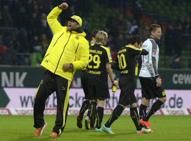 Borussia Dortmund's coach Klopp waves to supporters after the German Bundesliga first division soccer match against Werder Bremen in Bremen