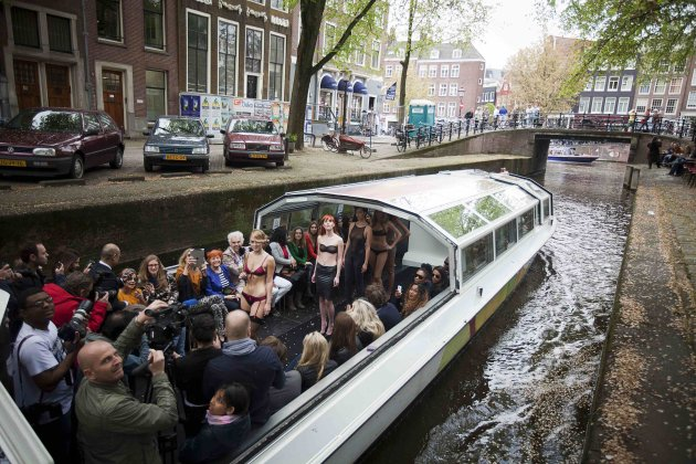 Models show creations by French lingerie Label Maison Close on the catwalk on a canal cruise boat of the Floating Fashion Week in Amsterdam