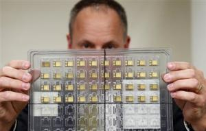 Craig Healy holds up seized radiation hardened integrated circuits in his office at the Export Enforcement Coordination Center in Northern Virginia