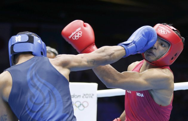 India's Vikas fights against Spence of the U.S. in their Men's Welter (69kg) Round of 16 boxing match during the London 2012 Olympic Games