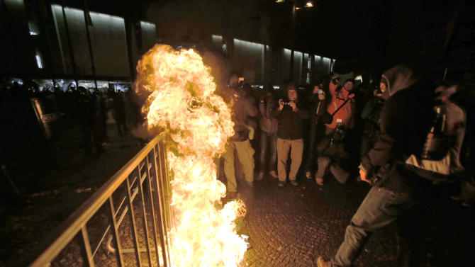 Protesters burn the European flag during an anti government protest in Ljubljana, Slovenia, Friday, Feb. 8, 2013. Thousands gathered to protest against the Janez Jansa led government and their policies. (AP Photo/Darko Bandic)