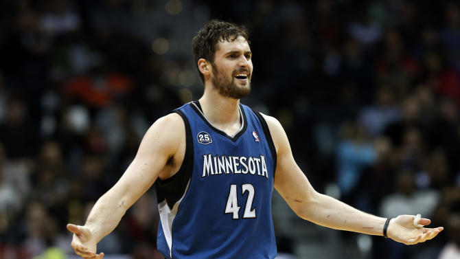 Minnesota Timberwolves forward Kevin Love reacts after a foul call during the second half of the Timberwolves' NBA basketball game against the Atlanta Hawks on Saturday, Feb. 1, 2014, in Atlanta. Atlanta won 120-113 despite Love's 43 points and 19 rebounds. (AP Photo/John Bazemore)