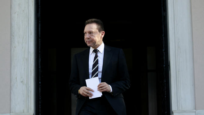 Greek Finance Minister Yannis Stournaras leaves the prime minister's official residence after talks with PM Antonis Samaras, in Athens, Thursday, Dec. 6, 2012. Greece's is finalizing a major tax reform bill, demanded by international rescue creditors as one of several conditions for continued payments. Greece's conservative-led government has promised to try and stem the country's punishing recession, but last month introduced another round of austerity measures. New unemployment figures, released Thursday, showed the country's jobless rate rising to 26 percent in September.  (AP Photo/Petros Giannakouris)