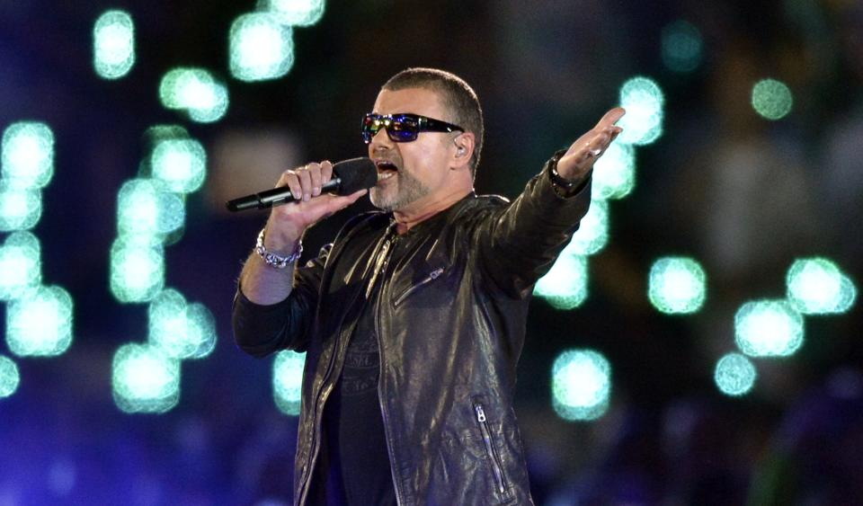 George Michael performs during the Closing Ceremony at the 2012 Summer Olympics, Sunday, Aug. 12, 2012, in London. (AP Photo/Martin Meissner)