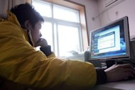A teenager uses a computer in 2007. Teenagers are increasingly deceiving their parents about where they go and what they do online, security technology firm McAfee said Monday in its latest survey on young people and the Internet