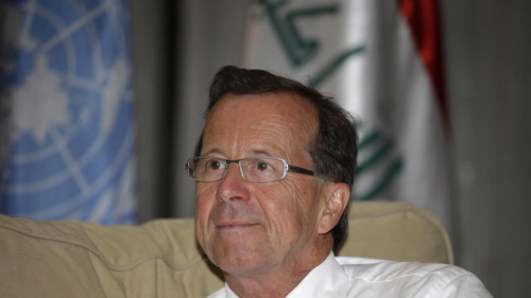 Martin Kobler, the top U.N. envoy to Iraq speaks during an interview with The Associated Press in the heavily protected Green Zone in Baghdad, Iraq, Wednesday, June 26, 2013. The United Nations envoy to Iraq says efforts to relocate residents of an Iranian dissident camp in Iraq are being stymied in part by lack of cooperation from the exiles themselves. Kobler told The Associated Press in an interview Wednesday that the difficulties add to the challenge of finding countries willing to accept members of the Mujahedeen-e-Khalq dissident group. (AP Photo/Karim Kadim)