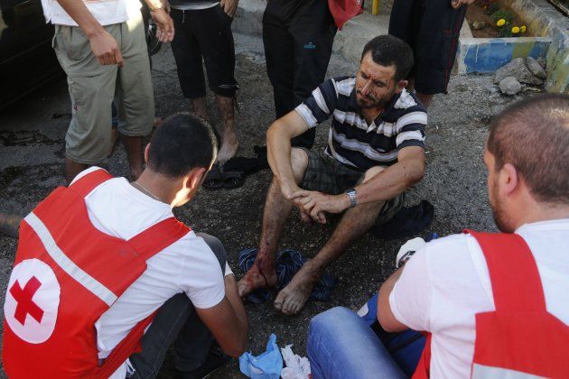Lebanese Red Corss treated a wounded man where two rockets hit their houses in Beirut suburbs