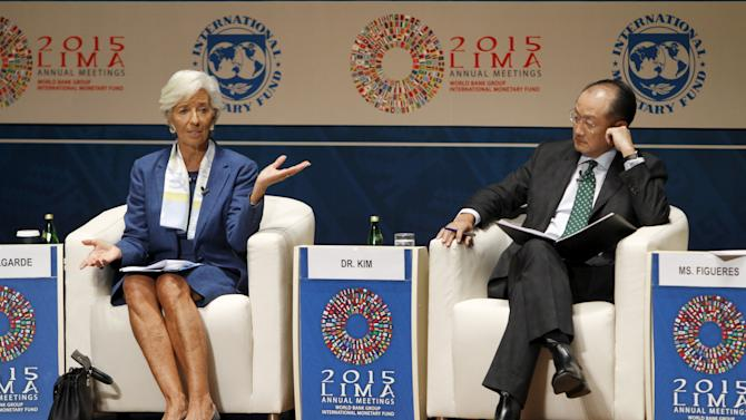 IMF Managing Director Lagarde and World Bank President Kim participate in an IMF-World Bank discussion during the 2015 Annual Meetings of the IMF and the World Bank in Lima