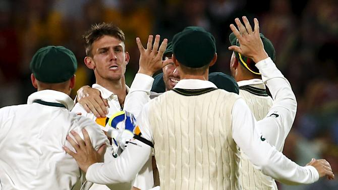Australia's Mitchell Marsh celebrates wikth team mates after he dismissed New Zealand's captain Brendon McCullum LBW for 20 runs during the second day of the third cricket test match at the Adelaide Oval, in South Australia