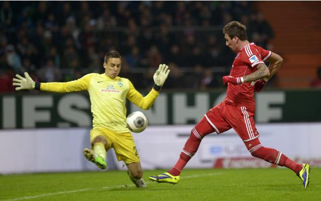 Werder Bremen's goalie Wolf and Bayern Munich's Mandzukic fight for the ball during their German Bundesliga first division soccer match in Bremen