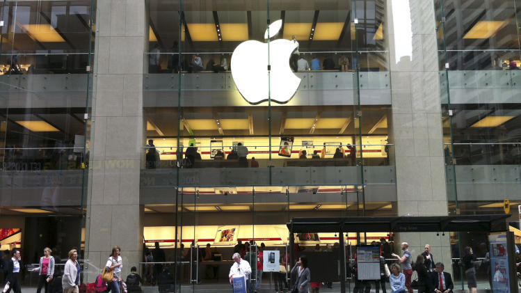 "People walk past an Apple store in Sydney's central business district in Australia, Tuesday, Dec. 11, 2012. Australian police are warning the public that errors in Apple's much-maligned mapping application are leading drivers headed to the southern city of Mildura to take a potentially ""life-threatening"" wrong turn into the middle of a remote state park. Apple's Maps service places the city of Mildura about 70 kilometers (44 miles) away in the Murray Sunset National Park, a desert-like 5,000 square kilometer (1,900 square mile) region with scorching temperatures and virtually no mobile phone reception.(AP Photo/Rob Griffith)"
