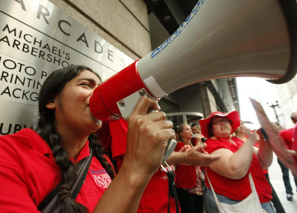 Chicago Teachers Union members picket prior to a Chicago Board of Education meeting on Wednesday, Aug. 22, 2012 in Chicago. The union called for fair contracts with higher pay for its teachers. (AP Photo/Sitthixay Ditthavong)
