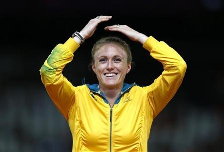 Australia's Pearson reacts on the podium before being presented with the gold medal for the women's 100m hurdles at the London 2012 Olympic Games in London
