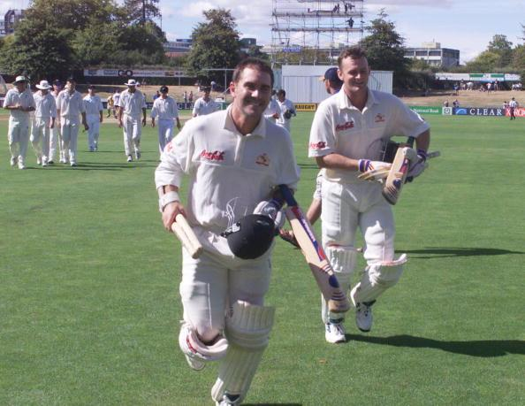 Australia's Justin Langer, left and Adam Gilchrist