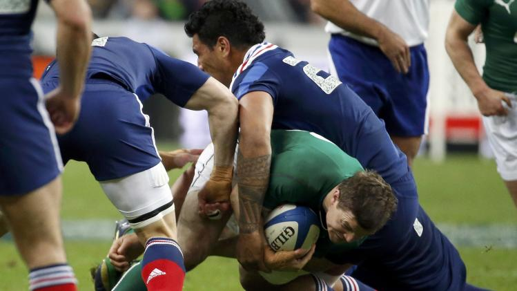 Ireland's O'Driscoll challenges France's Vahaamahina during their Six Nations rugby union match at the Stade de France in Saint-Denis, near Paris