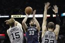 Grizzlies&#039; Gasol shoots against Spurs&#039; Bonner and Splitter during the second half of Game 1 of their NBA Western Conference final playoff basketball game in San Antonio