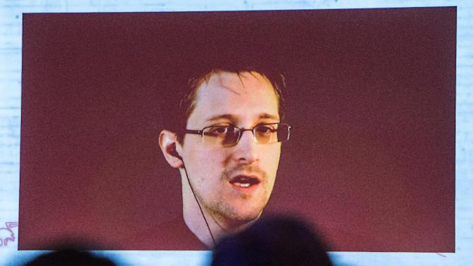 US National Security Agency whistleblower Edward Snowden speaks via live video call during the CeBIT technology fair in Hanover, central Germany, on March 18, 2015