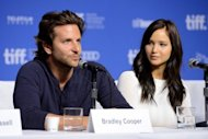 "Actors Bradley Cooper and Jennifer Lawrence speak onstage at the ""Silver Linings Playbook"" Press Conference during the 2012 Toronto International Film Festival on September 9, 2012 in Toronto, Canada"