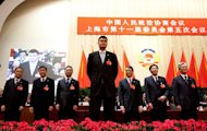 China's former NBA superstar Yao Ming (C) attends a Chinese People's Political Consultative Conference (CPPCC) meeing in Shanghai, as newly elected member of the CPPCC, on January 15, 2011. The CPPCC is a 2,000-strong advisory body which includes China's other token political parties and a few celebrities, including Yao