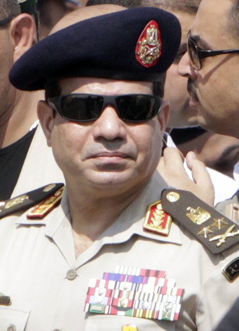 Army Chief General Abdel Fattah al-Sisi attends the military funeral service of police General Nabil Farag, who was killed on Thursday in Kerdasa.