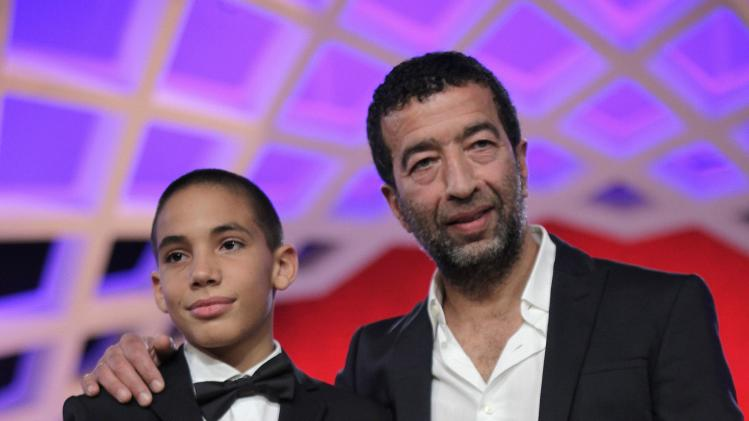 Michon and Dazi hold the best actor award that they were both awarded at the 13th edition of the International Film Festival of Marrakech