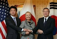 "Hillary Clinton (C) meets with Japanese Foreign Minister Koichiro Gemba (L) and South Korean Foreign Minister Kim Sung-hwan during a tri-lateral aside the 67th UN General Assembly in New York on September 28. Clinton insisted that Asian nations have ""a responsibility"" to lower tensions amid a heated war of words between regional powers over disputed island chains"