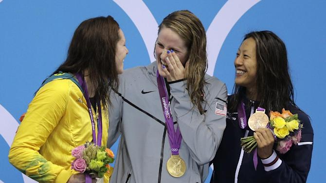 Australia's silver medalist Emily Seebhom, left, United States' gold medalist Missy Franklin, center, and Japan's bronze medalist Aya Terakawa, right, react after their wins in the women's 200-meter freestyle swimming semifinal at the Aquatics Centre in the Olympic Park during the 2012 Summer Olympics in London, Monday, July 30, 2012. (AP Photo/Matt Slocum)