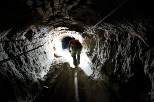 A Palestinian man works at a tunnel used for smuggling goods into the Gaza Strip