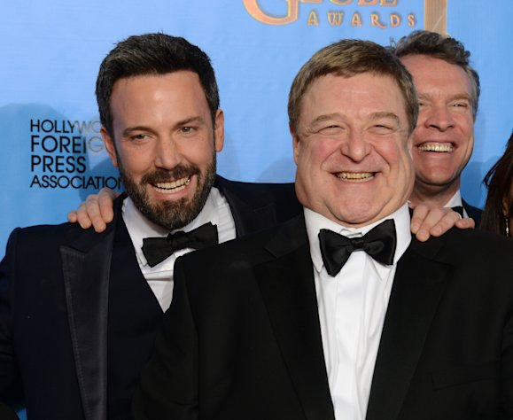 Actor and director Ben Affleck, left, and actor John Goodman pose with the award for best motion picture - drama for &quot;Argo&quot; backstage at the 70th Annual Golden Globe Awards at the Beverly Hilton Hotel on Sunday Jan. 13, 2013, in Beverly Hills, Calif. (Photo by Jordan Strauss/Invision/AP)