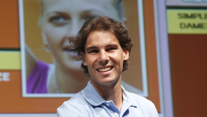 Spain's Rafael Nadal attends the draw for the 2013 French Open tennis tournament, at Roland Garros stadium in Paris, Friday May, 24, 2013. (AP Photo/Christophe Ena)