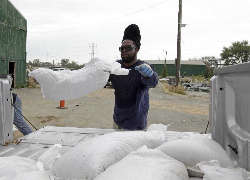 Indianapolis Department of Public Works employee Toraine Briggs loads sandbags into a truck in Indianapolis, Friday, Aug. 31, 2012.  Hundreds lined up to take advantage of free sandbags as they prepare for heavy rains expected   as slow-moving Isaac makes its way north and east. (AP Photo/Michael Conroy)