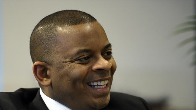 """Transportation Secretary Anthony Foxx speaks during an interview with the Associated Press at the Transportation Department in Washington, Tuesday, Jan. 14, 2014. Americans spend a total of 600,000 years stuck in traffic every year. The nation has about 100,000 bridges old enough for Medicare. And a recent global ranking put the United States' infrastructure in 25th place, just behind Barbados. But Foxx says he sees signs the nation may finally be ready to tackle its """"infrastructure deficit."""" (AP Photo/Susan Walsh)"""