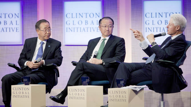 Ban Ki-Moon, left, Secretary-General of the United Nations, and Jim Yong Kim, center, President of the World Bank, listen to former U.S. President Bill Clinton during a panel discussion at the Clinton Global Initiative, Sunday, Sept. 23, 2012 in New York. (AP Photo/Mark Lennihan)