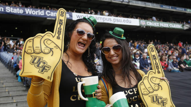 UCF Knights fans cheer on their side as they play Penn State Nittany Lions during the Croke Park Classic College Football match in Dublin, Ireland, Saturday, Aug. 30,2014. University of Central Florida hosted Penn State in their 2014 football Season Opener Saturday. This big season opener for UCF and Penn State is the first time that they have played outside the United States. (AP Photo/Peter Morrison)