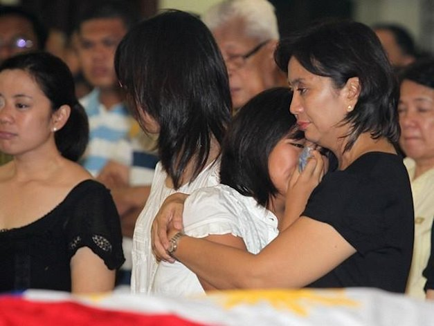 The wife of the late Interior and Local Government Secretary Jesse Robredo, Atty. Leni and daughters Aika, Patricia and Jillian joins Robredo's' followers during the Holy Mass for the public viewing at the Archbishop's Palace in Naga City (Ryan Lim, MPB, NPPA Images).