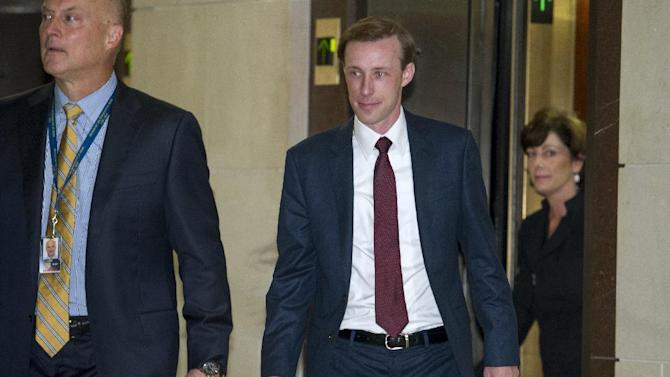 Former Hillary Clinton aide, during her tenure as Secretary of State, Jake Sullivan, center, arrives to be interviewed before a House panel on the Benghazi investigation on Capitol Hill in Washington, Friday, Sept. 4, 2015.  Sullivan, a former policy director and deputy chief of staff at the State Department, will be questioned Friday in what is expected to be a daylong session.  (AP Photo/Cliff Owen)
