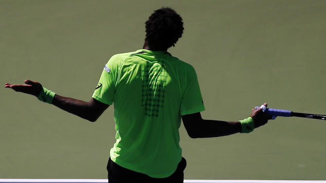 Gael Monfils, of France, reacts after a shot to Alejandro Gonzalez, of Colombia, during the second round of the 2014 U.S. Open tennis tournament, Friday, Aug. 29, 2014, in New York