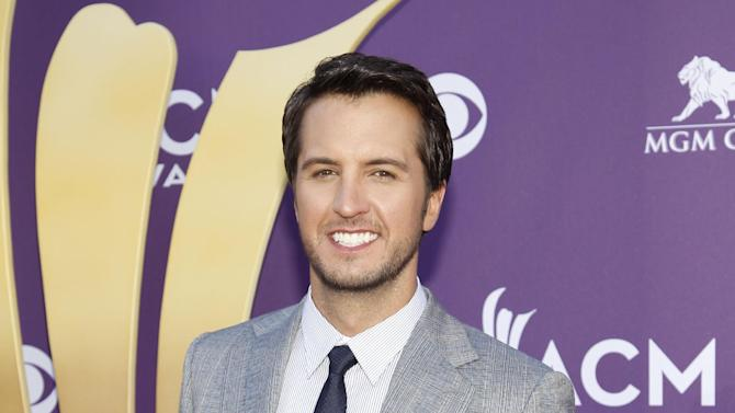 "FILE - This April 1, 2012 file photo shows country singer Luke Bryan at the 47th Annual Academy of Country Music Awards in Las Vegas. Bryan is joining Blake Shelton as co-host of the 2013 Academy of Country Music Awards on April 7. Bryan replaces Reba McEntire, who served as host for more than a decade before stepping aside to concentrate on her new sit-com ""Malibu Country."" (AP Photo/Isaac Brekken, file)"
