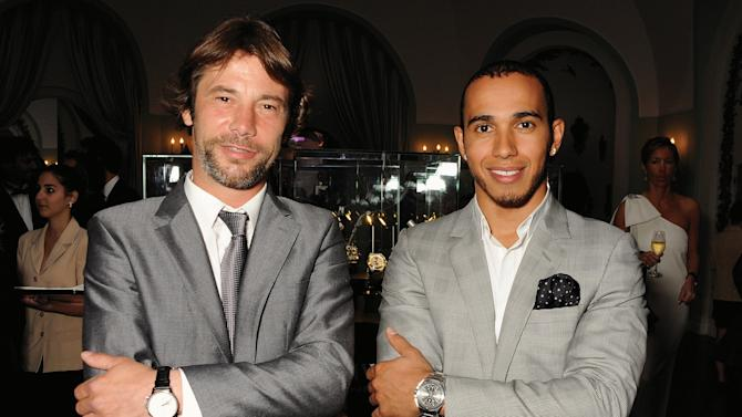 "DISTRIBUTED FOR IWC - Musician Jay Kay (L) and Formula 1 driver Lewis Hamilton attend the exclusive ""For The Love Of Cinema"" event hosted by Swiss luxury watch manufacturer IWC Schaffhausen at the Hotel du Cap-Eden-Rocin in Antibe, France, on Sunday, May 19, 2013.  (David M. Benett for IWC/Photopress via AP Images)"