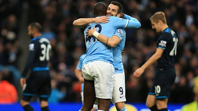 Manchester City's Alvaro Negredo (centre right) celebrates with team-mate Yaya Toure