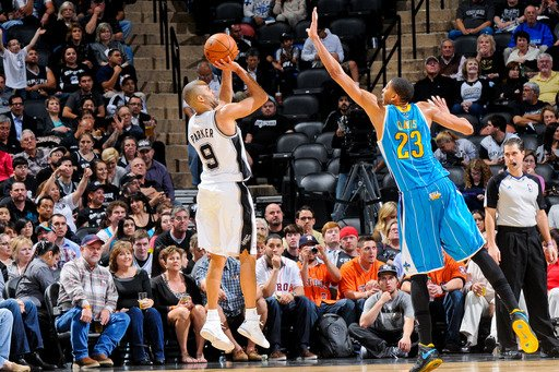 SAN ANTONIO, TEXAS - JANUARY 23: Tony Parker #9 of the San Antonio Spurs shoots against Anthony Davis #23 of the New Orleans Hornets on January 23, 2013 at the AT&T Center in San Antonio, Texas. (Photo by D. Clarke Evans/NBAE via Getty Images)