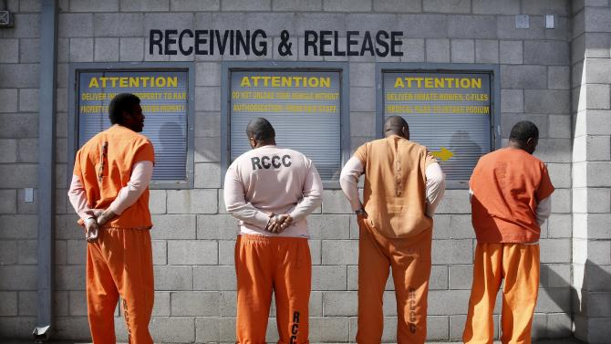 In this photo taken Thursday, Feb. 20, 2014, prisoners from Sacramento County await processing after arriving at the Deuel Vocational Institution in Tracy, Calif. California counties are thwarting the state's efforts to comply with a federal court order to reduce it's inmate population by sending state prisons far more convicts than anticipated including a record number of second-strikers. The state is trying to comply with a landmark restructuring of its criminal justice system through a nearly 3-year-old law pushed by Gov. Jerry Brown that keeps lower-level felons in county jails while reserving scarce state prison cells for serious, violent and sexual offenders.(AP Photo/Rich Pedroncelli)