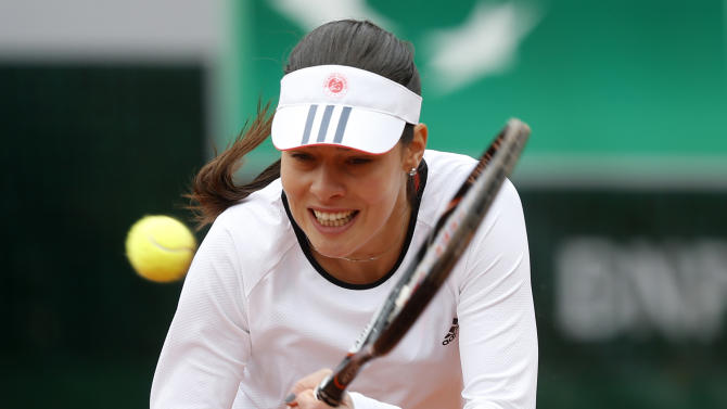 Serbia's Ana Ivanovic returns the ball to Croatia's Petra Martic during their first round match of the French Open tennis tournament at the Roland Garros stadium Sunday, May 26, 2013 in Paris. (AP Photo/Petr David Josek)