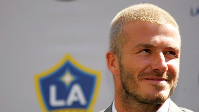 CARSON, CA - JULY 13: David Beckham looks on during his official introduction as a Los Angeles Galaxy player on July 13, 2007 at the Home Depot Center in Carson, California. (Photo by Stephen Dunn/Getty Images)
