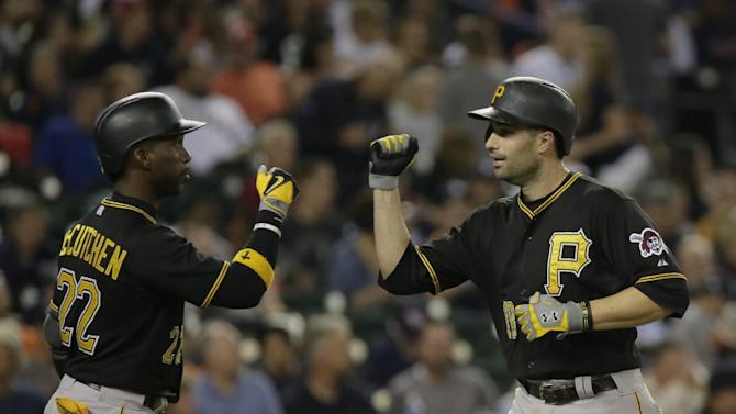 Pittsburgh Pirates' Neil Walker, right, is congratulated by Andrew McCutchen (22) after hitting a solo home run during the eighth inning of a baseball game Wednesday, July 1, 2015, in Detroit. Walker hit two home runs and had three RBI's in the Pirates 9-3 win. (AP Photo/Duane Burleson)