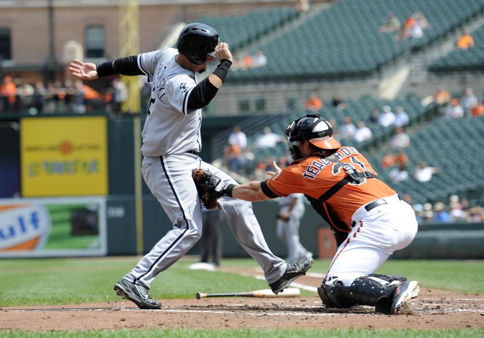 Chicago White Sox's A.J. Pierzynski (12) is tagged out by Baltimore Orioles catcher Taylor Teagarden (31) during the second inning of a baseball game, Thursday, Aug. 30, 2012, in Baltimore. (AP Photo/Nick Wass)