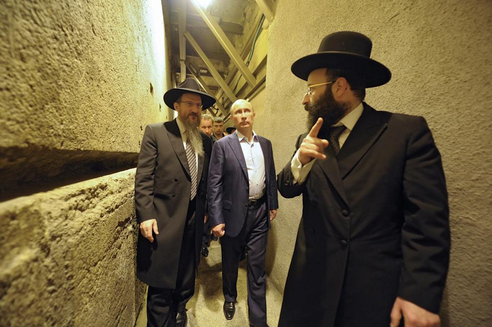 Russian President Vladimir Putin, center, visits the Western Wall, the holiest site, where Jews can pray, early Tuesday, June 26, 2012. (AP Photo/RIA-Novosti, Alexei Druzhinin, Presidential Press Service)