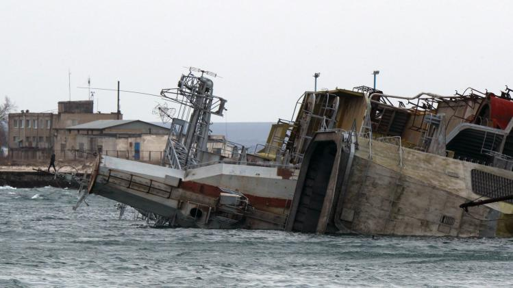 An abandoned naval ship sunk by the Russian navy to block the entrance is seen in the Crimean port of Yevpatorya
