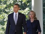 U.S. President Barack Obama walks with Secretary of State Hillary Clinton to deliver remarks following the death of the U.S. Ambassador to Libya, Chris Stevens and others, from the Rose Garden of the White House in Washington