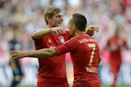 Bayern Munich&#39;s Franck Ribery and Toni Kroos celebrate a goal during their Bundesliga match against TSG 1899 Hoffenheim, in Munich, on October 6. Bayern Munich bounced back from their midweek Champions League defeat in Belarus as Ribery scored both goals in their 2-0 win